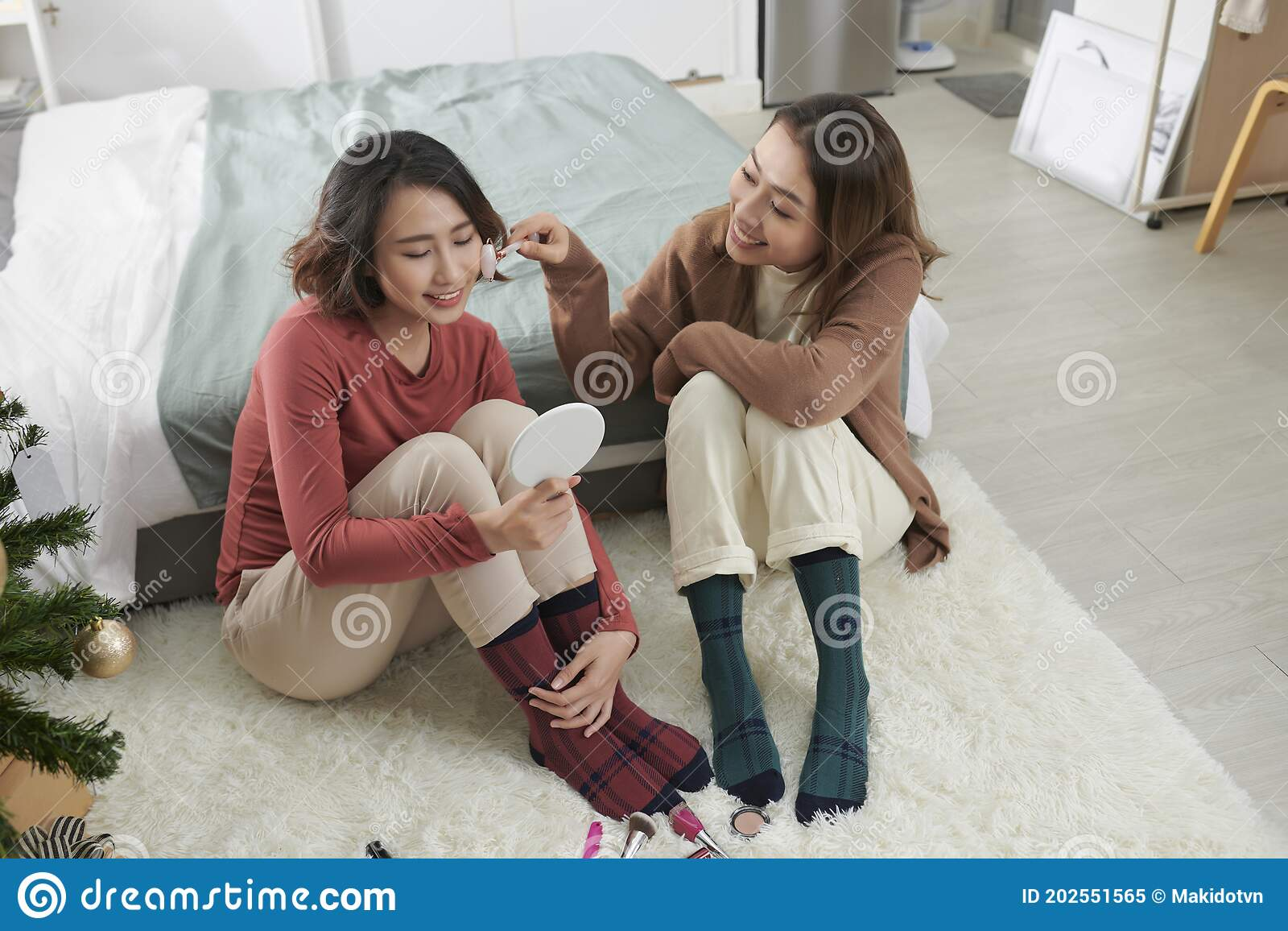 Two Girls Facial Treatment Together With Massage Device