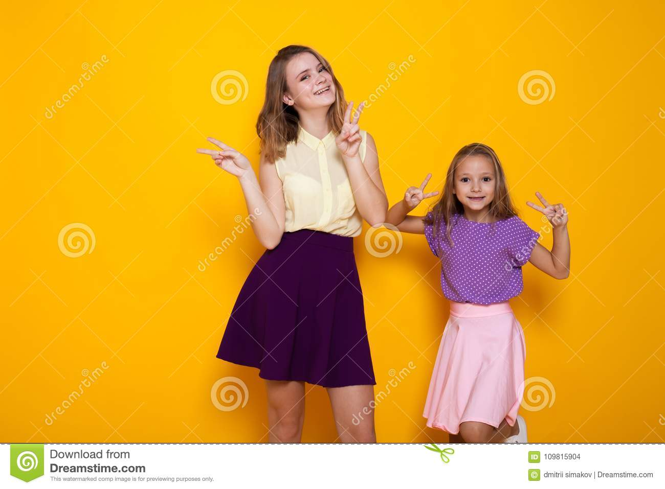 Two Girls Having Fun Show Fingers