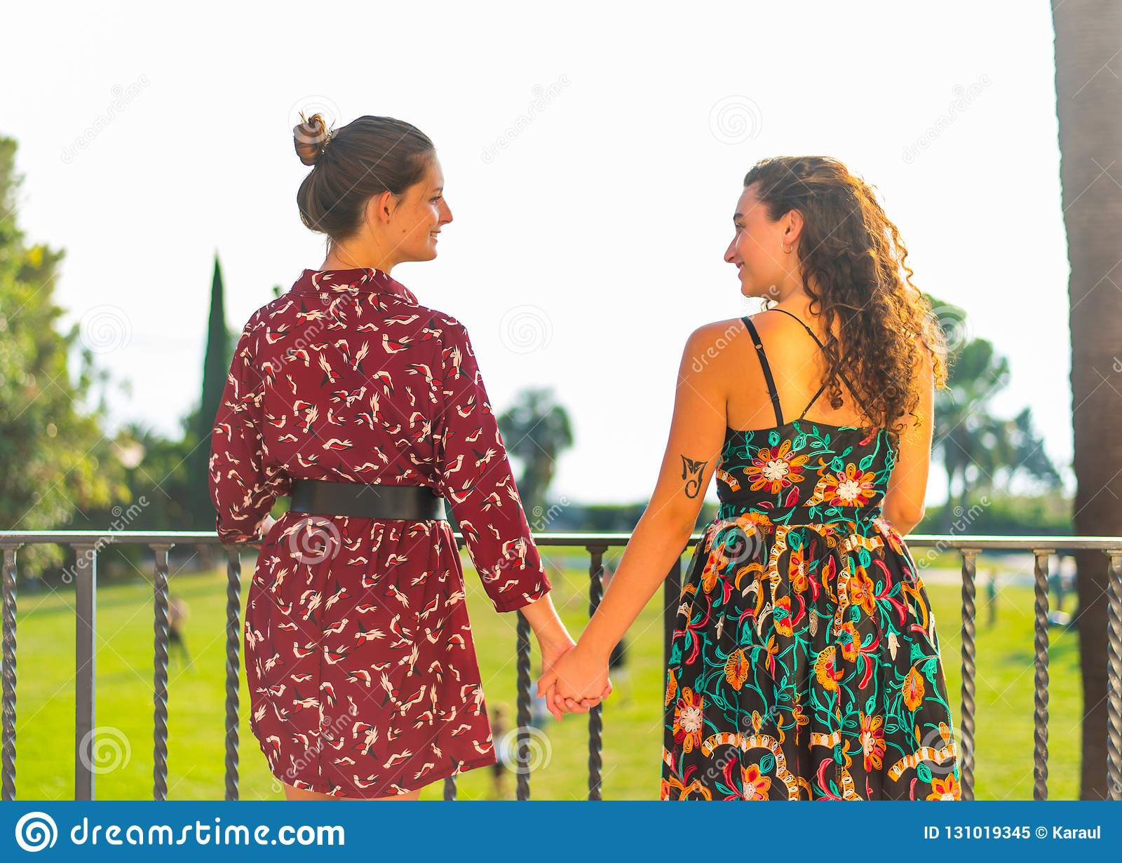 Two girls holding hands and having fun