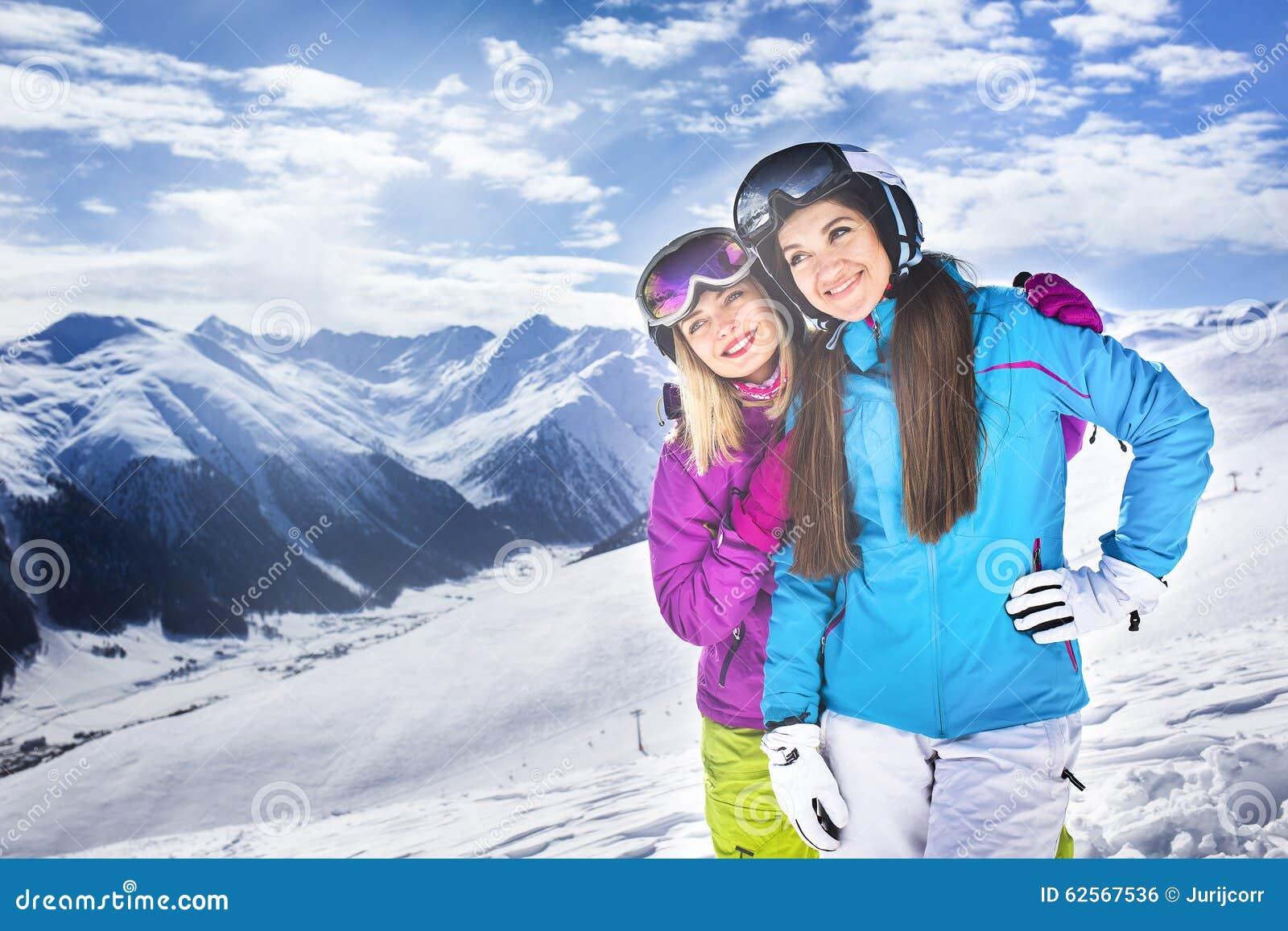 Two Girls Hugging In Winter Ski Resort Blue Sky Stock Photo - Image ... 961cc407d