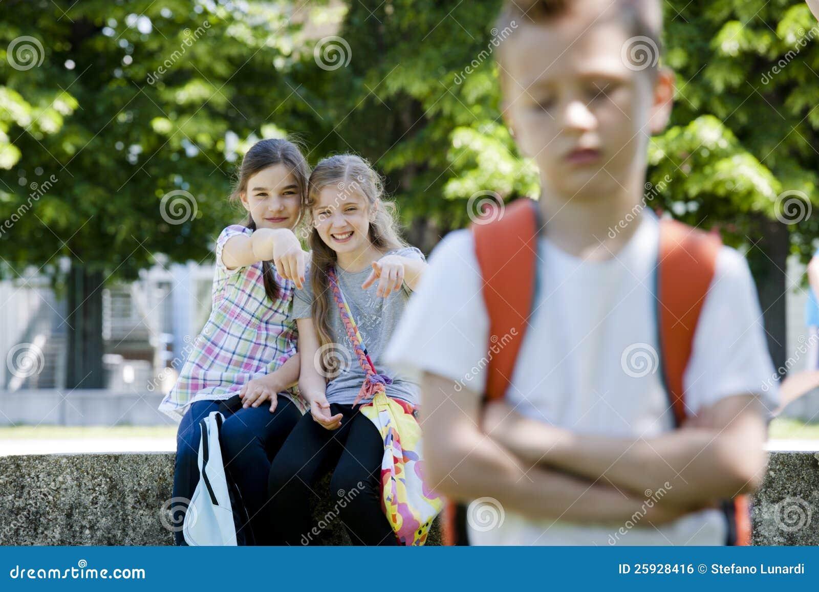Two Girls Mocking A Boy Royalty Free Stock Image