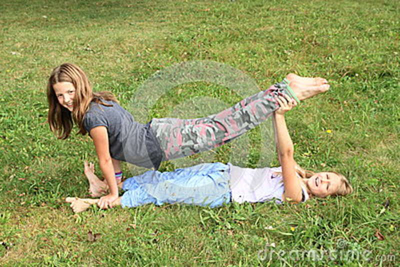 https://thumbs.dreamstime.com/z/two-girls-playing-exercising-yoga-meadow-little-barefoot-kids-supported-exercises-one-above-another-holding-feet-green-79985519.jpg