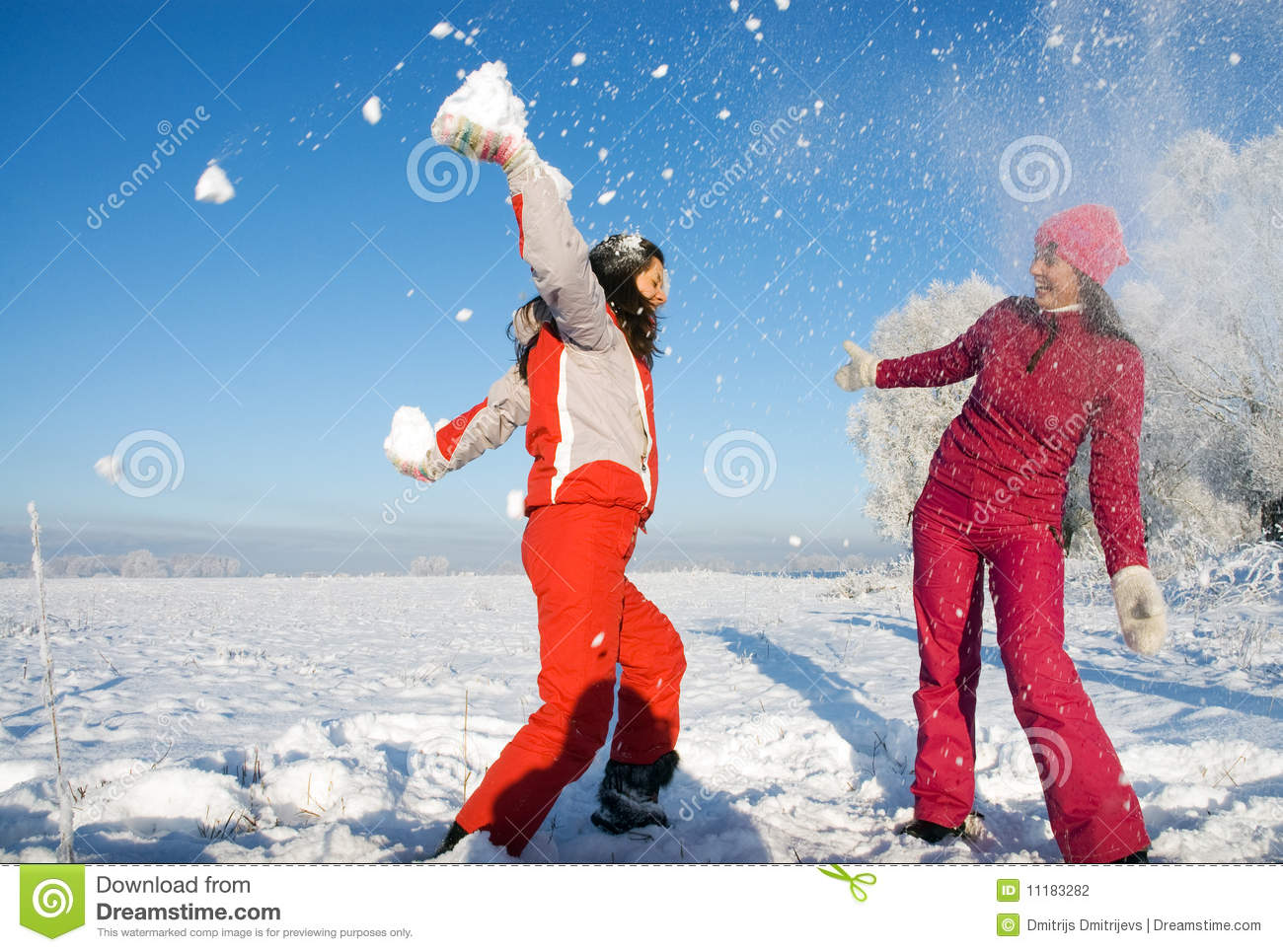 Two girls playing with snow