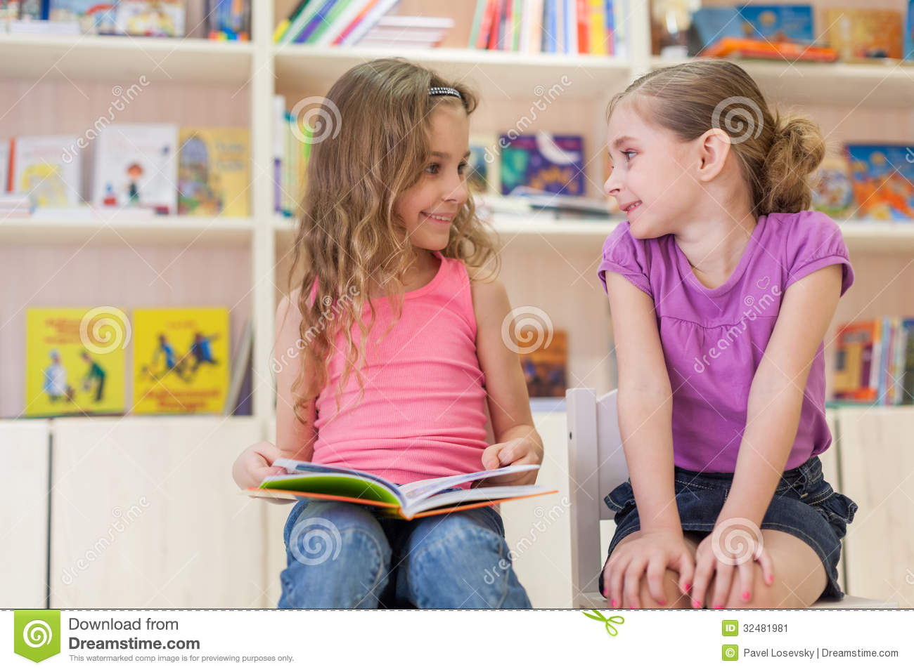 2 girls reading a dirty magazine 2