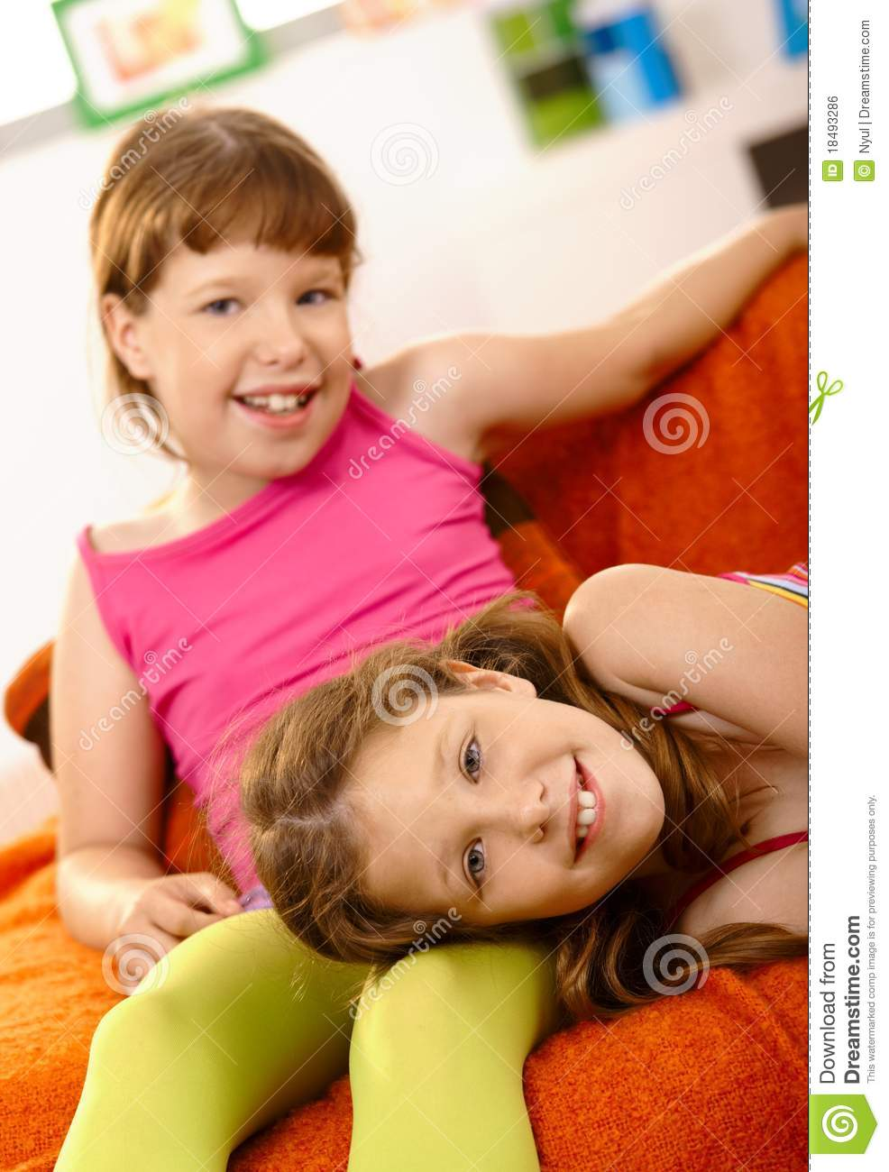 two girls relaxing at home royalty free stock image. Black Bedroom Furniture Sets. Home Design Ideas