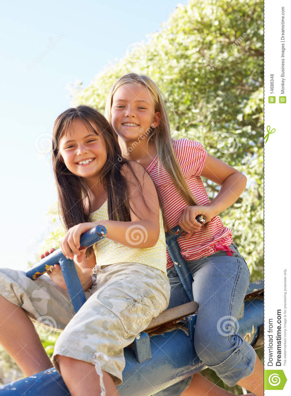 Music Classroom Design ~ Two girls riding on see saw in playground royalty free