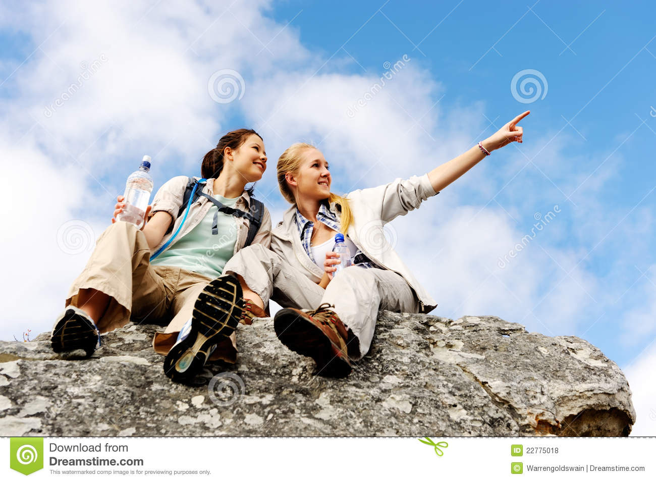 Two girls on a rock