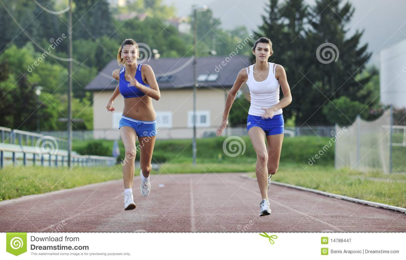 450060a508e1 Two Girls Running On Athletic Race Track Stock Image - Image of life ...