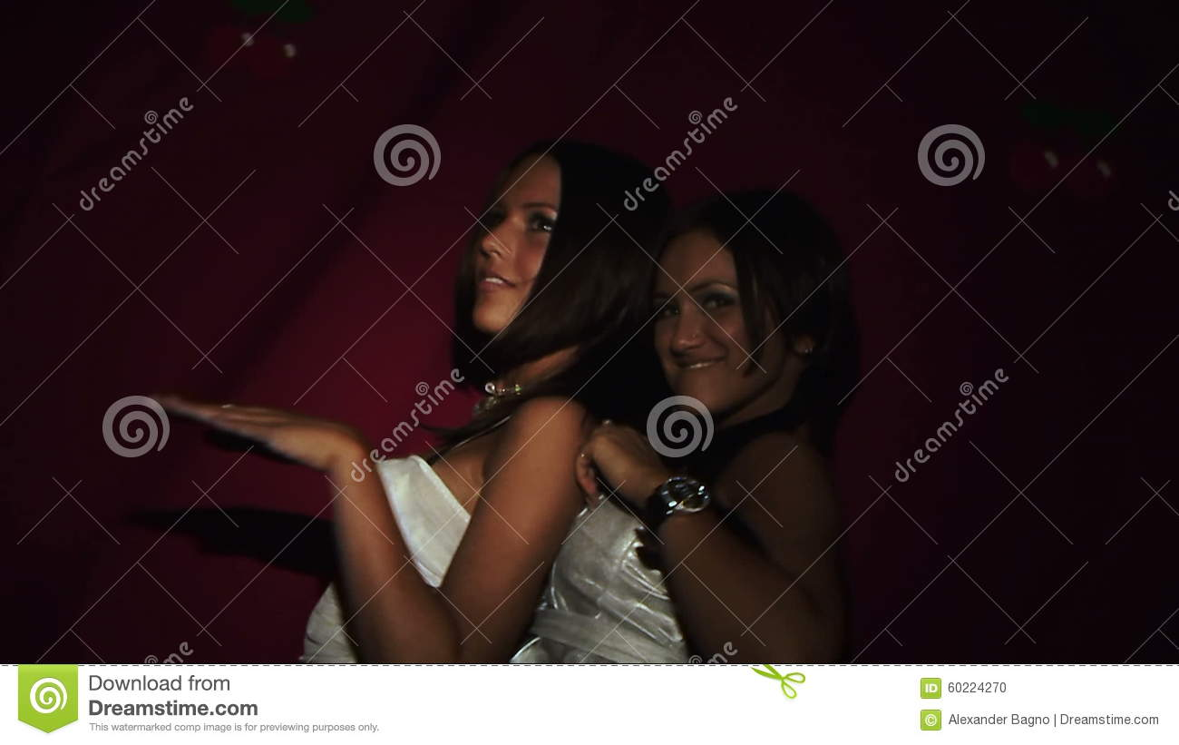 e3c4aee2f Two Girls In Short Dress And Boots Dancing In Stock Footage - Video ...
