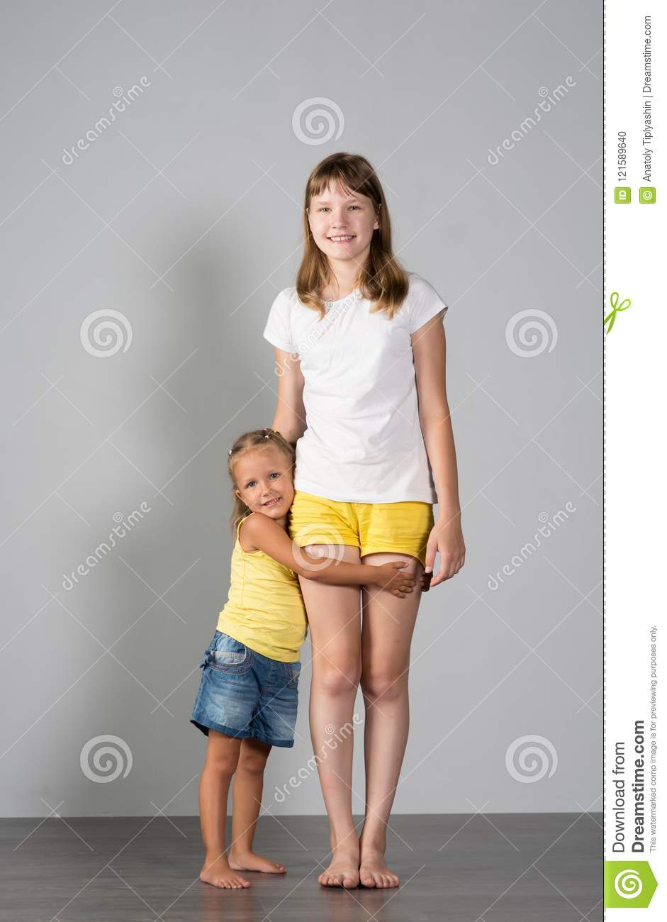 Two girls sisters teenager and child