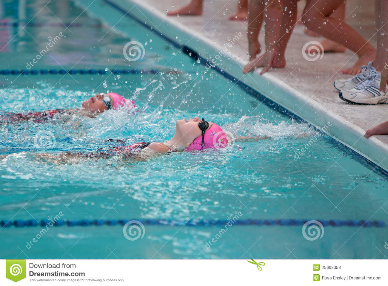 Two Girls Swimming Backstroke Reach For Wall Editorial