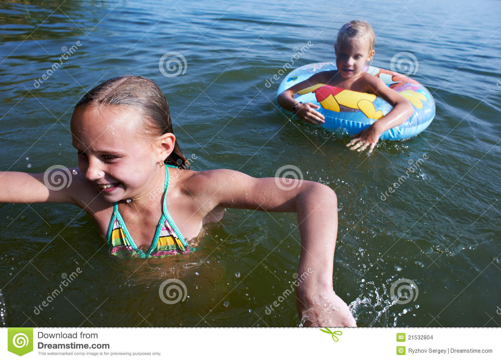 Kids Swimming In A Lake two swimming kids in lake royalty free stock images - image: 14246529