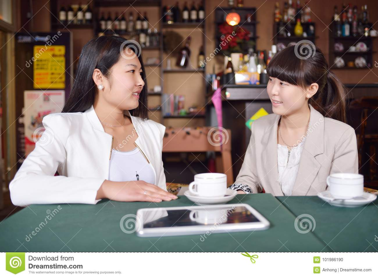 Cafe young girls chat stock photo. Image of adult, cheerful ...