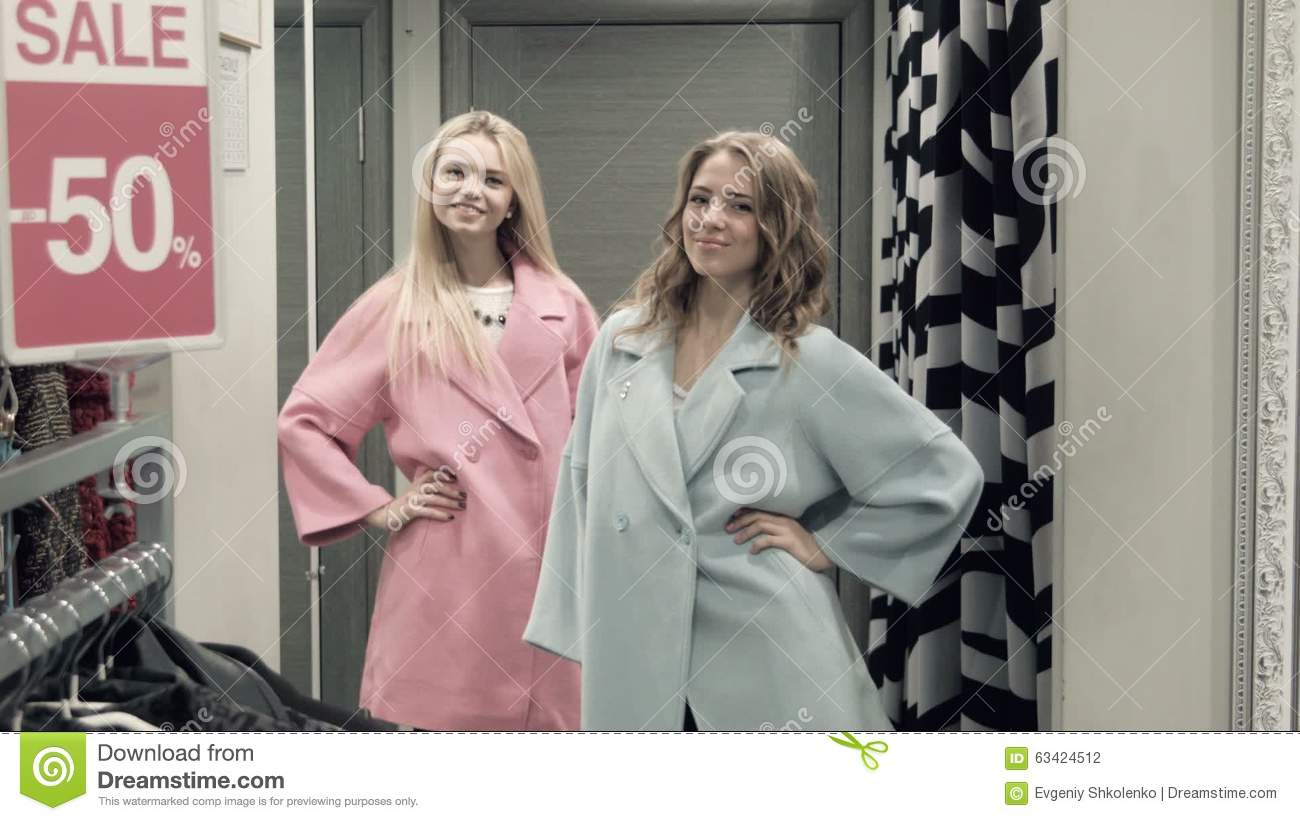 Two Girls Try On A Coat In A Locker Room Stock Footage - Video of ...