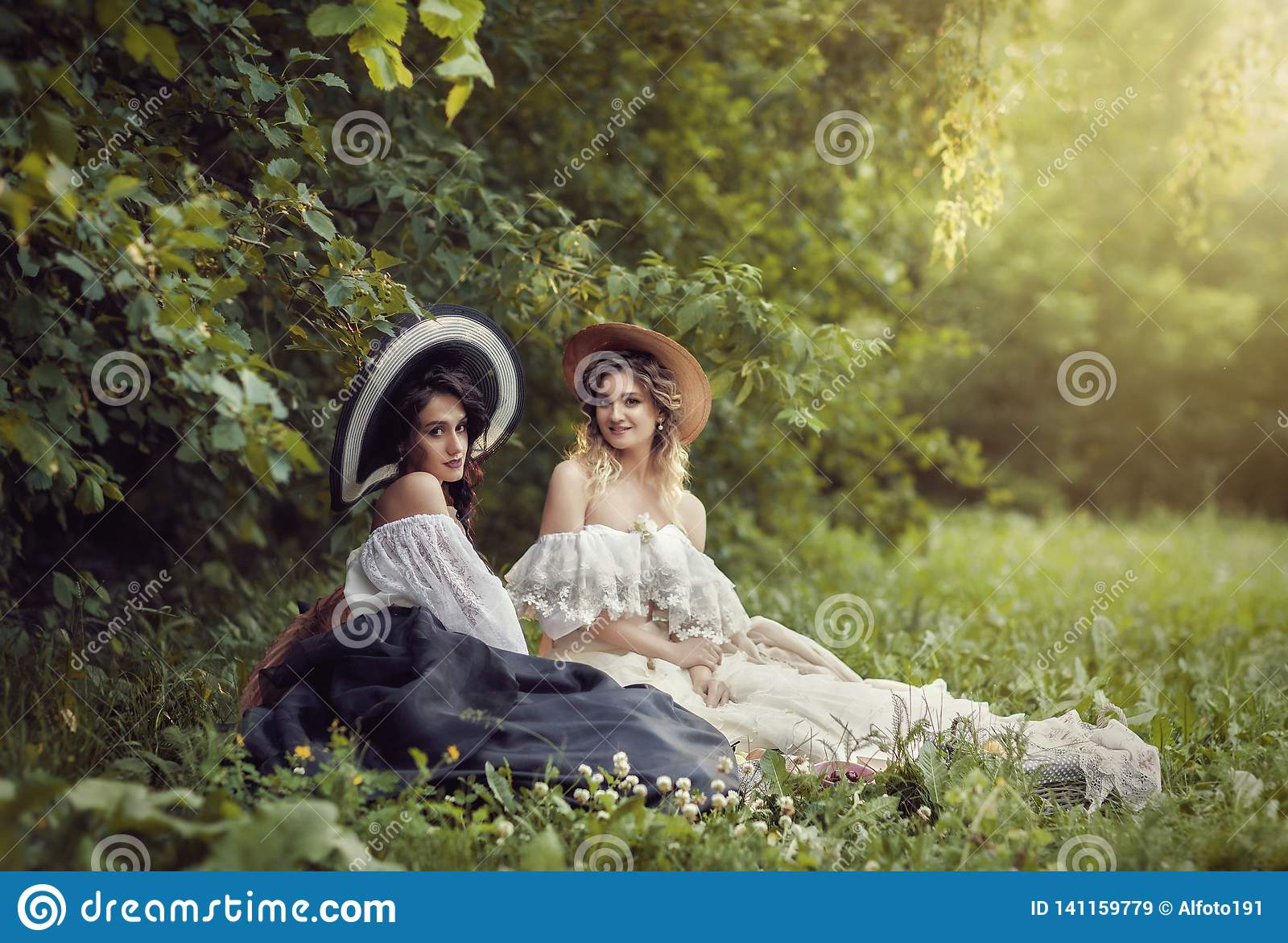 Two girls in vintage clothes and hats