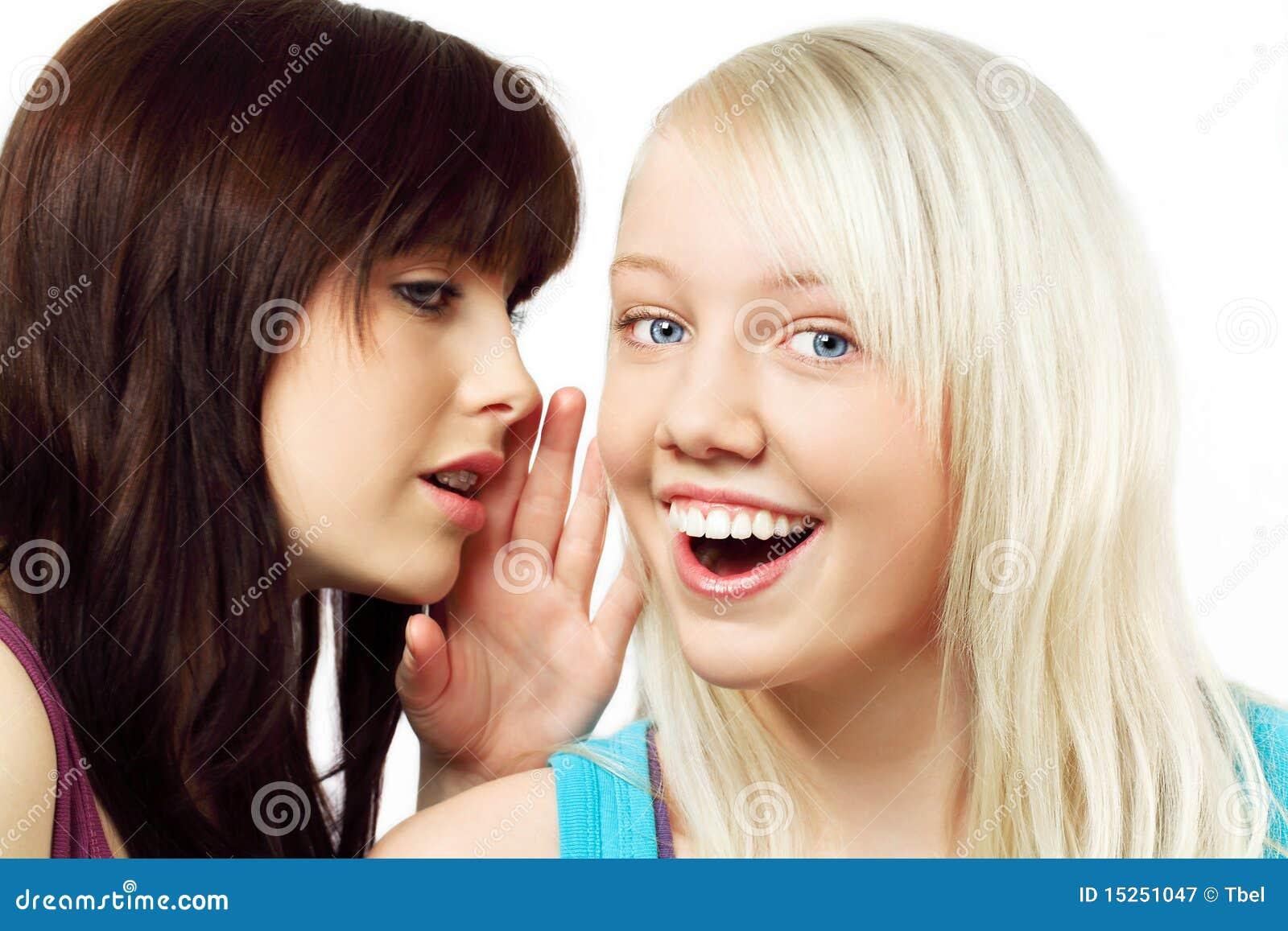 Two-girls-whispering-15251047