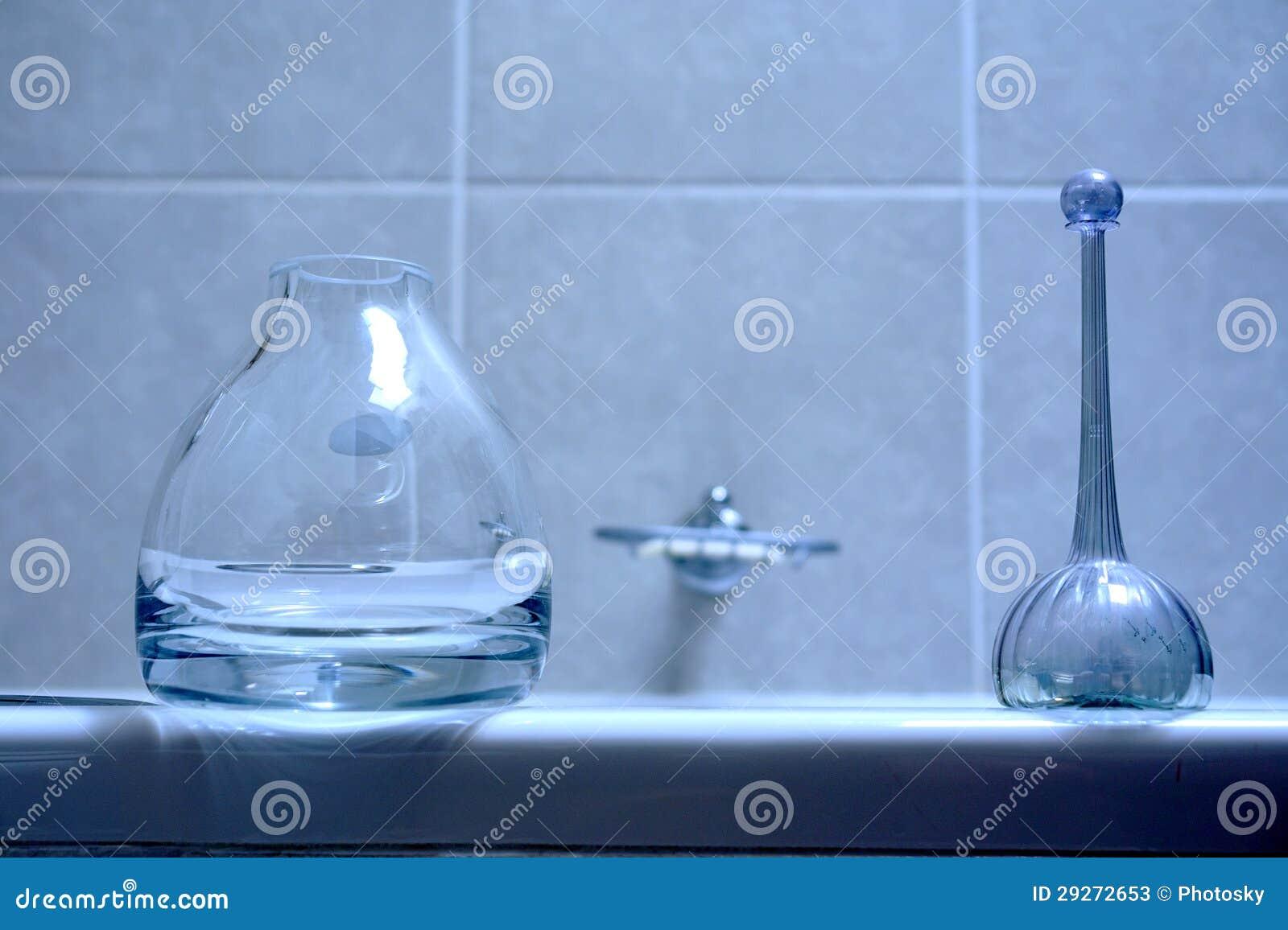 Two glass bottles in bathroom stock photos image 29272653 for Bathroom bottles