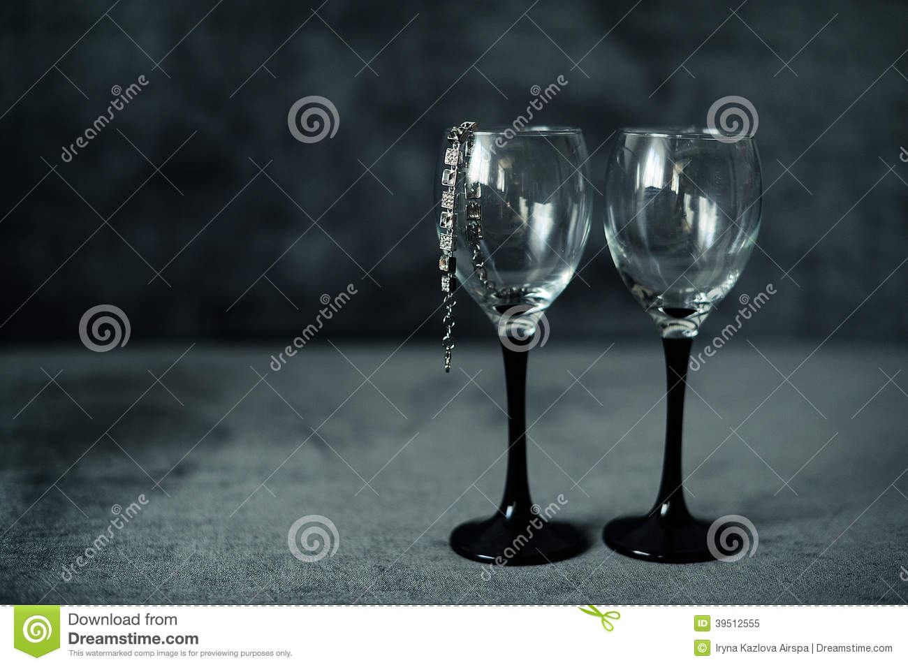 Two glasses with a bracelet