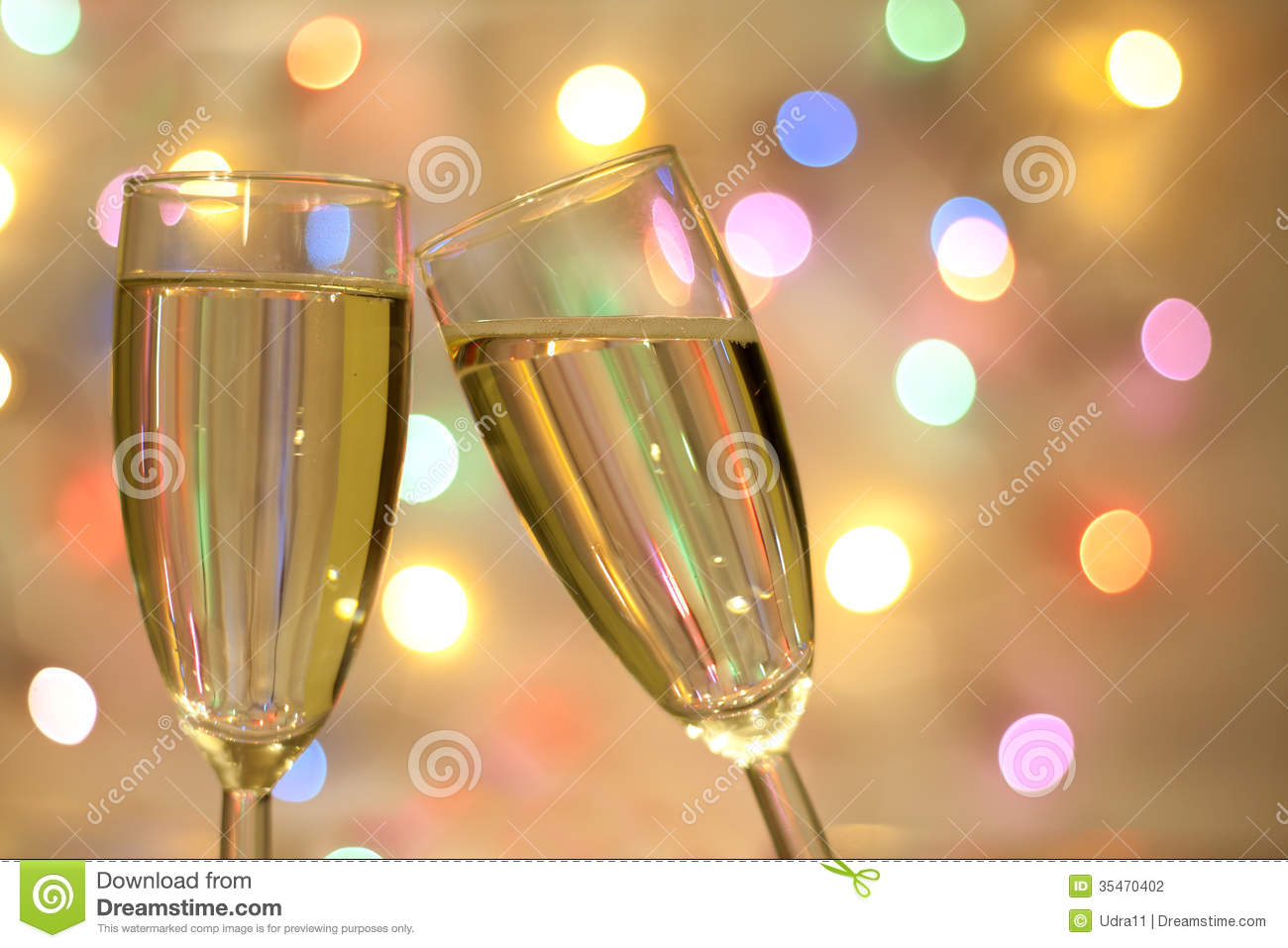 two glasses of champagne on blurred new year background stock photo 35470402 megapixl