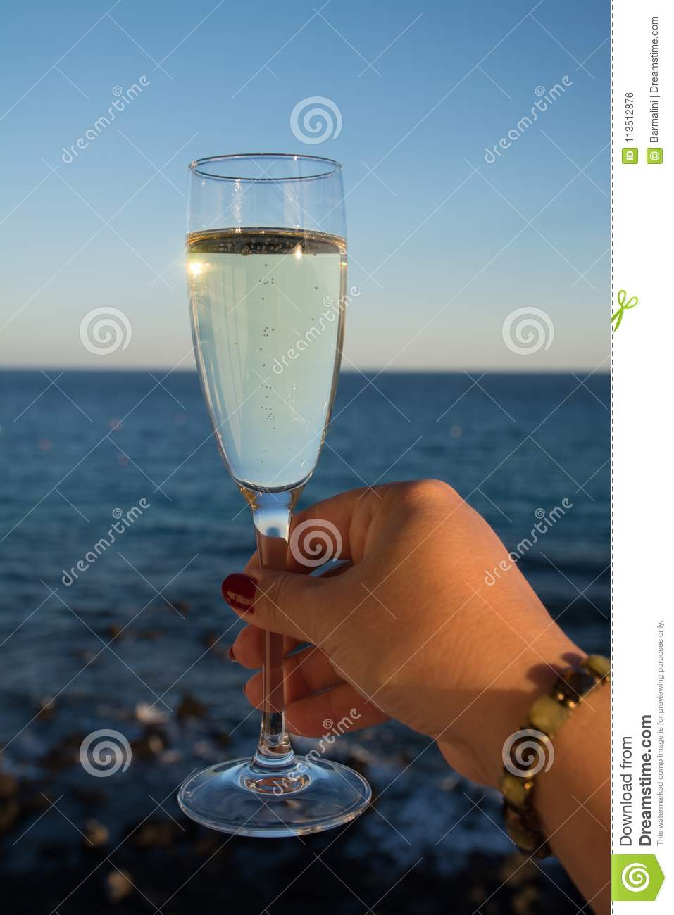 Two glasses with champagne or cava served outside on terrace, lu