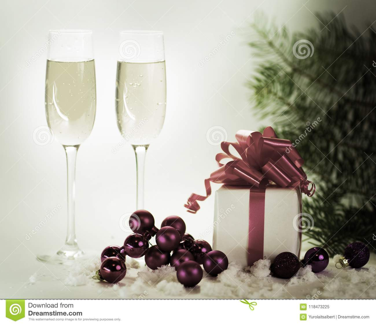 Two glasses of champagne with gifts ready to bring in the New Year