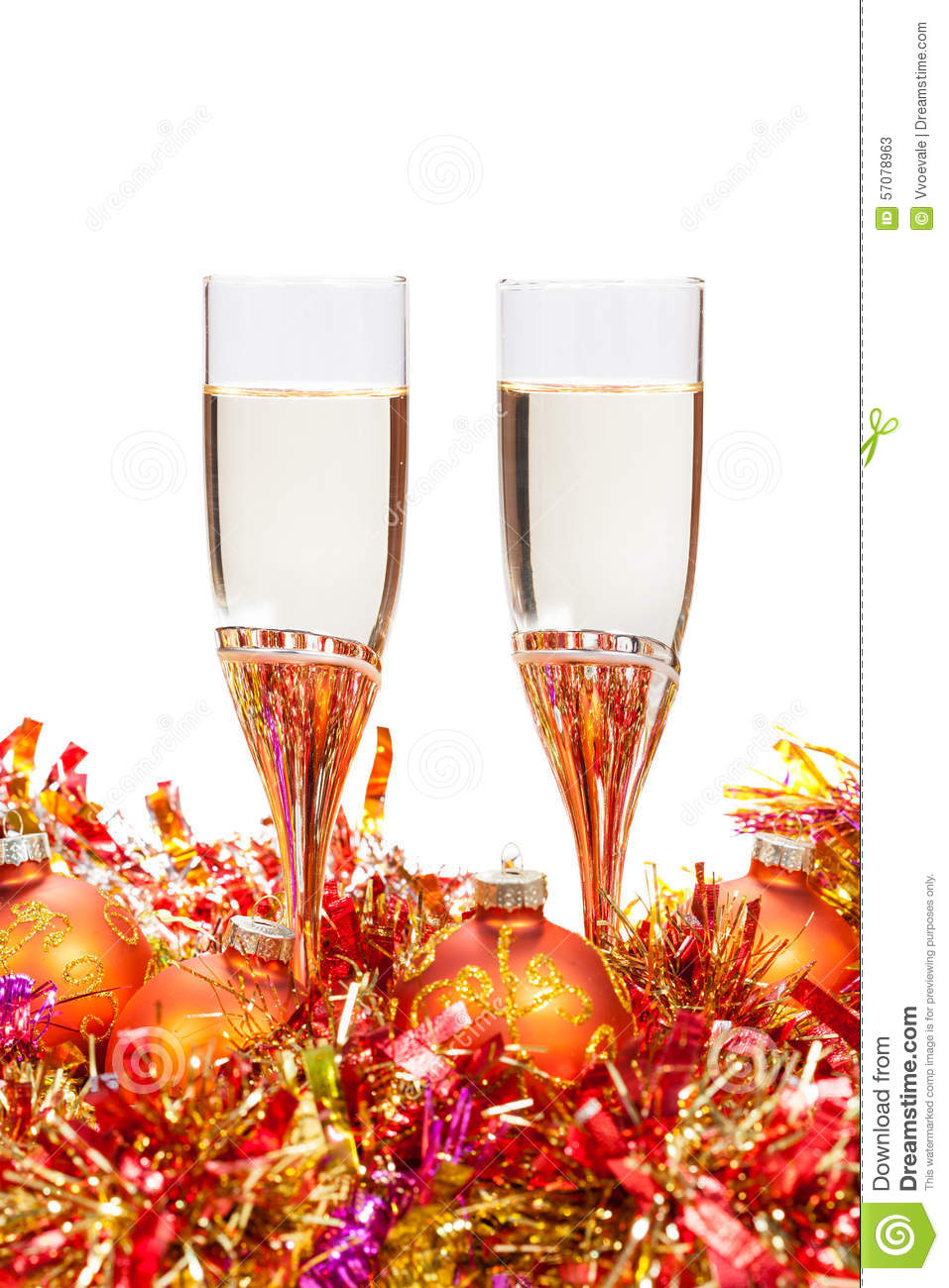 Two glasses of champagne and gold christmas bauble stock for Crystal baubles christmas