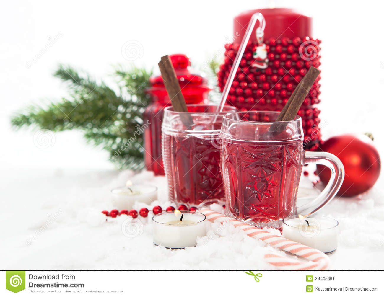 Two glasses of mulled wine and candle with Christmas decorations