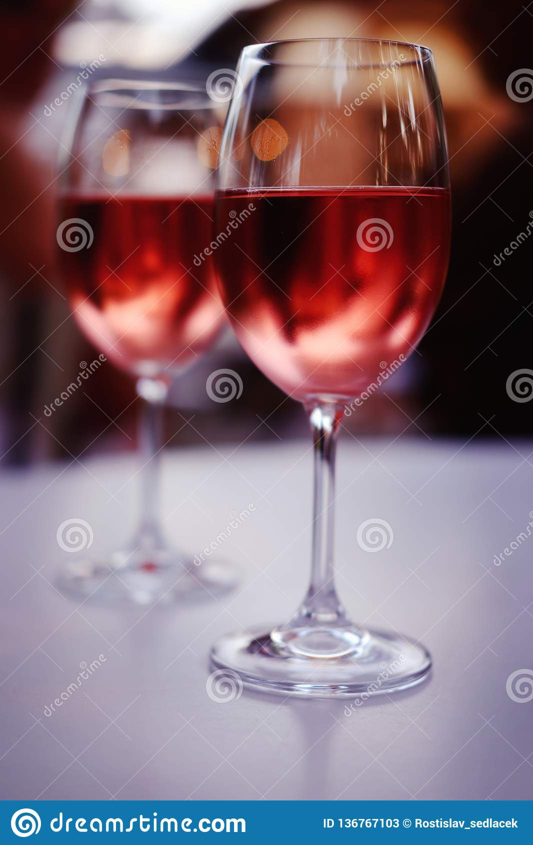 Two glasses of pink wine on a table