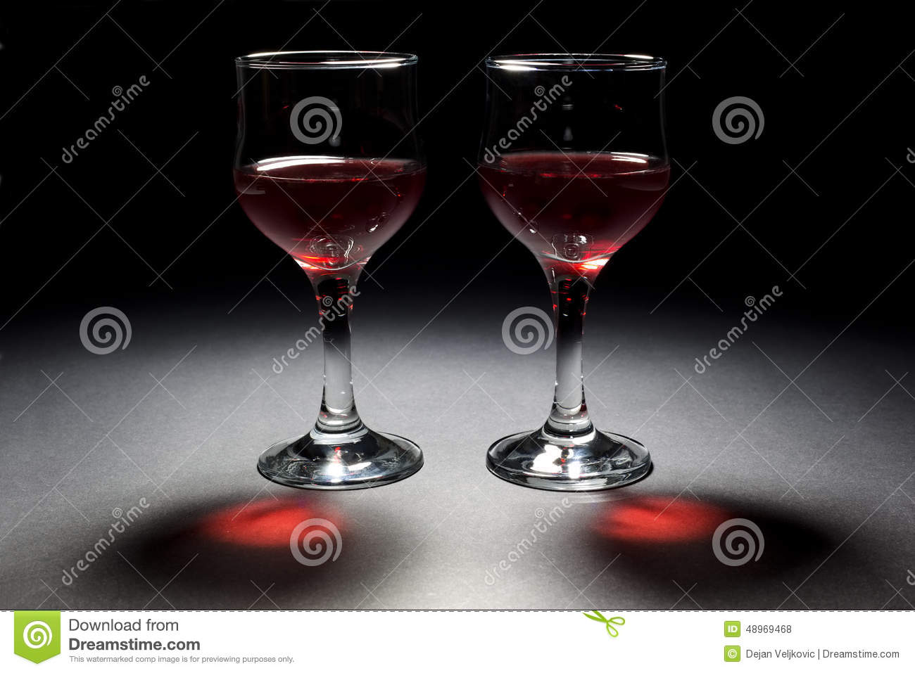 Two Glasses Of Red Wine And Their Interesting Reflection