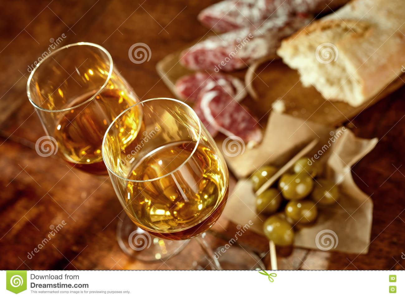 Two glasses of sherry with Spanish tapas