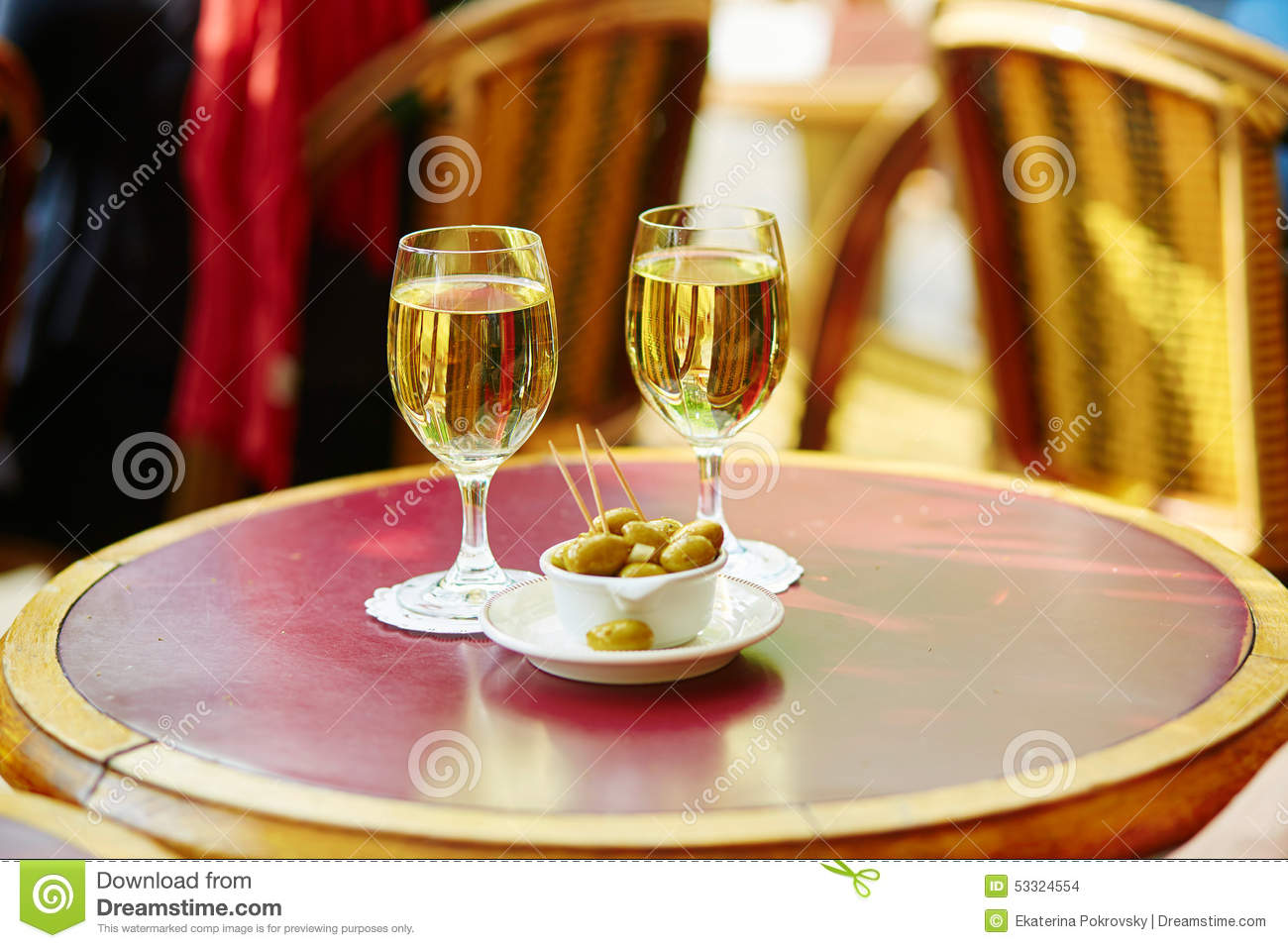 Two glasses of white wine and olives