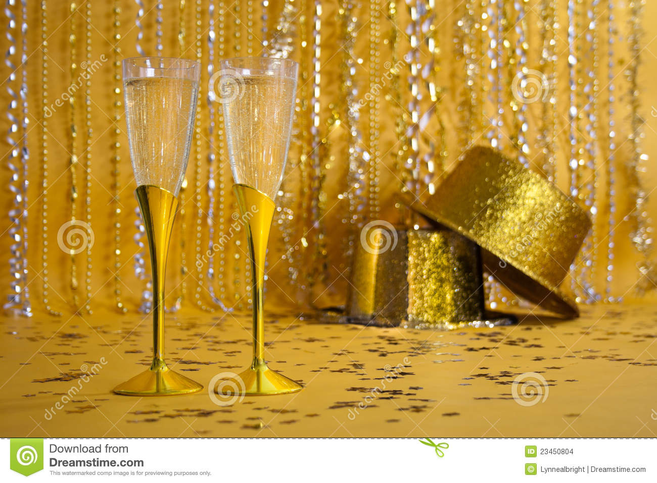 Two Gold Champagne Flutes With Sequined Party Hats Stock