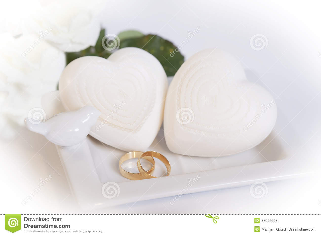 Two Gold Wedding Bands and Hearts