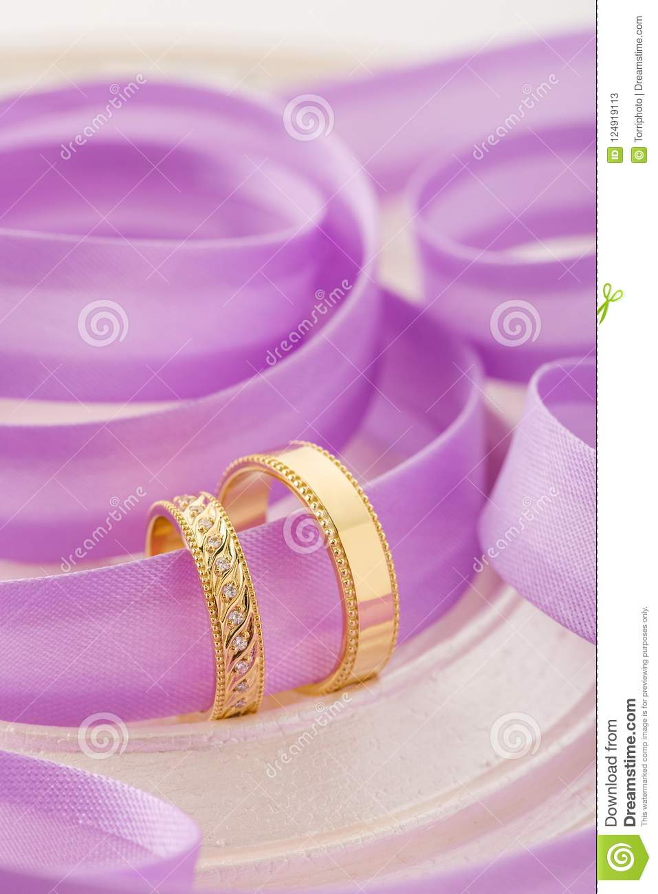 Two Gold Wedding Rings On Purple Ribbon Background Stock Image ...