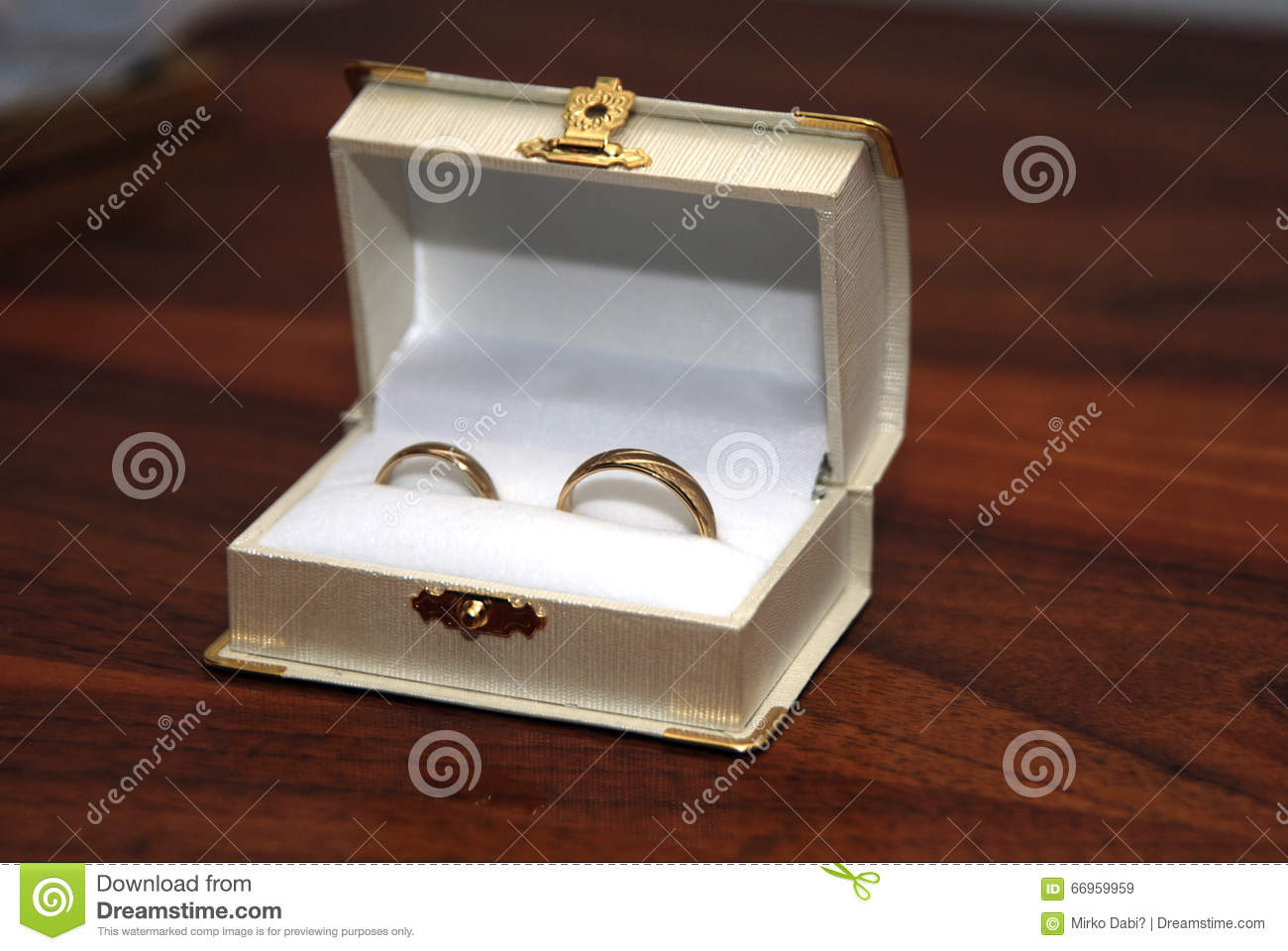 two gold wedding rings in the white ring box - Wedding Ring Box