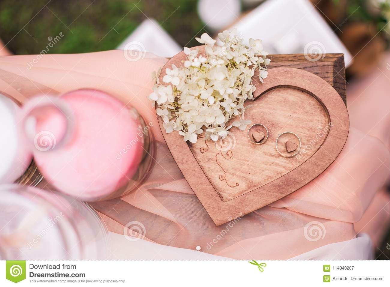 Two Golden Wedding Rings On Wooden Heart Background Stock Image ...