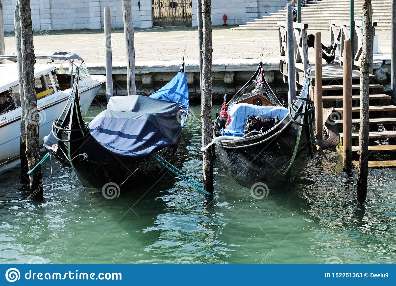 Two gondolas moored on Grand Canal in VEnice, Italy