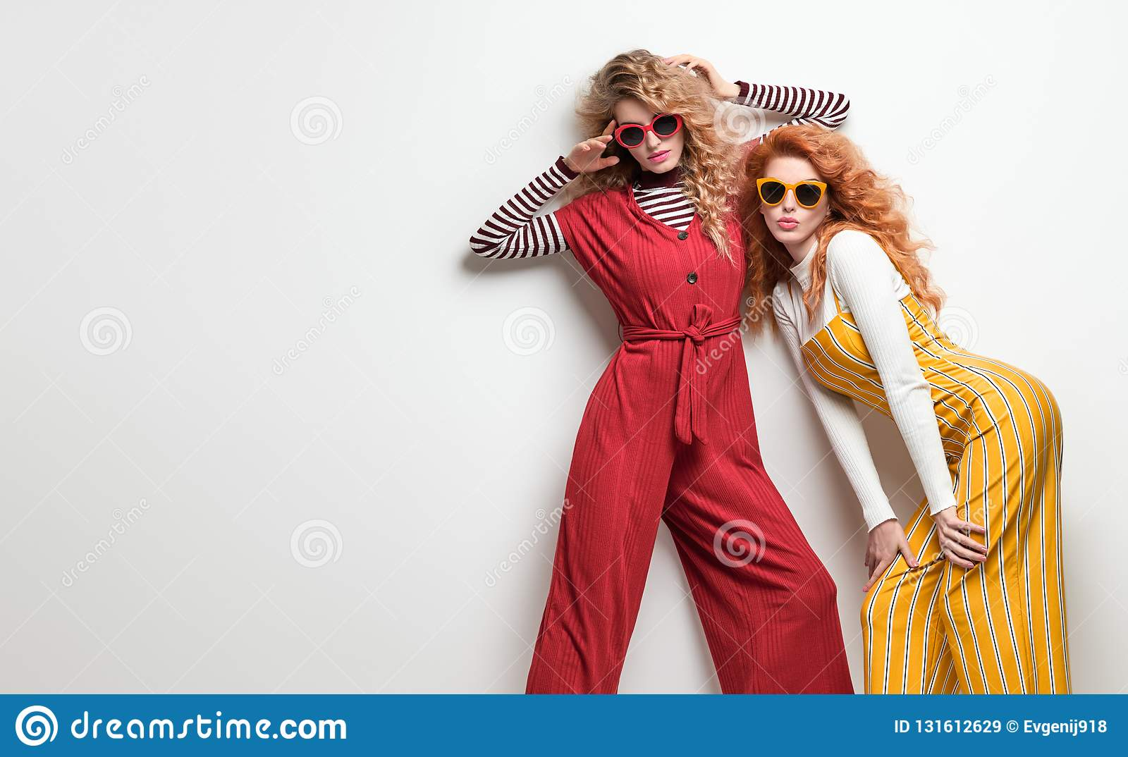 Two Gorgeous Girl in Fashion Outfit. Curly Hair