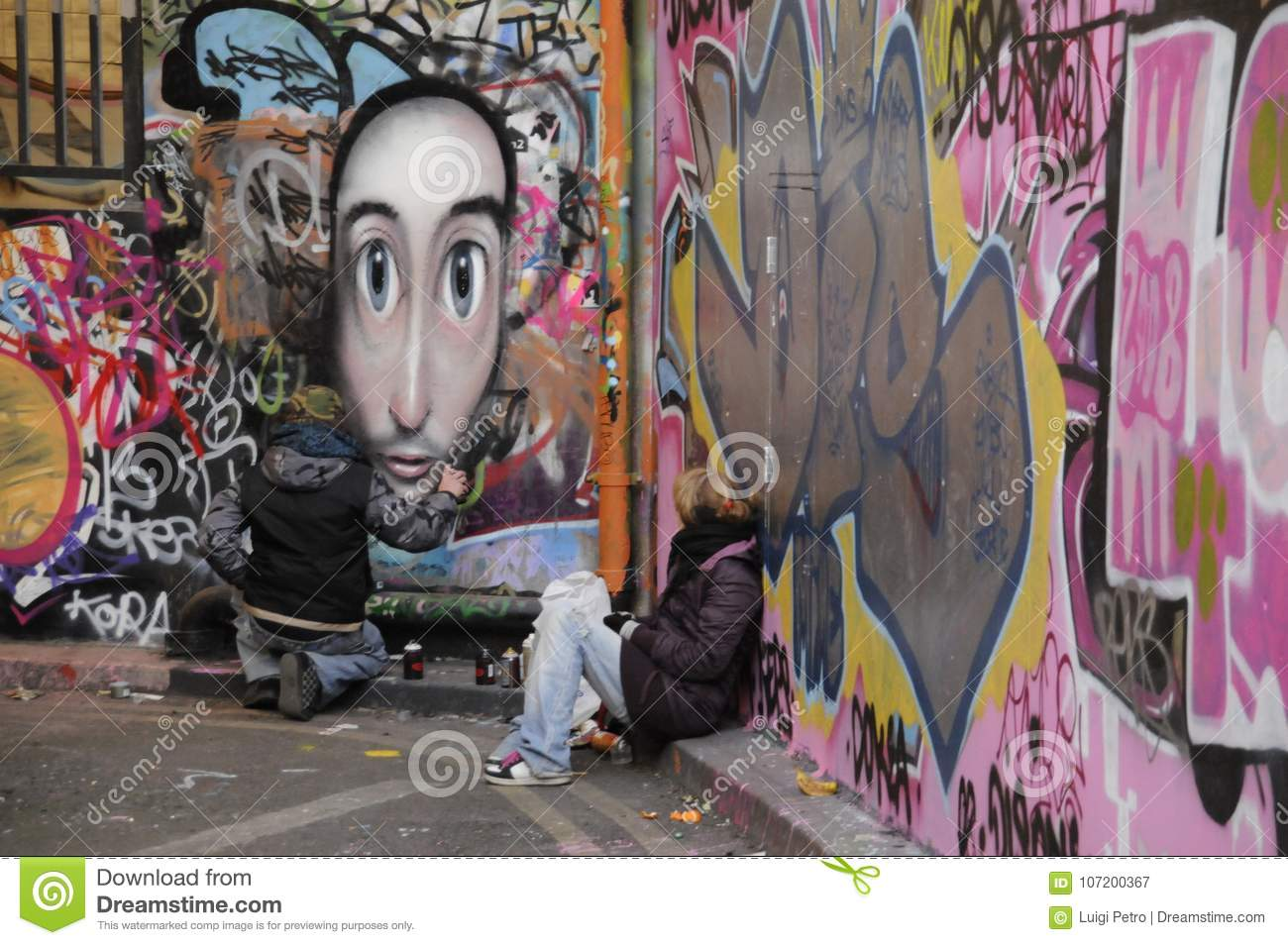 two graffiti artists at work editorial photography image of