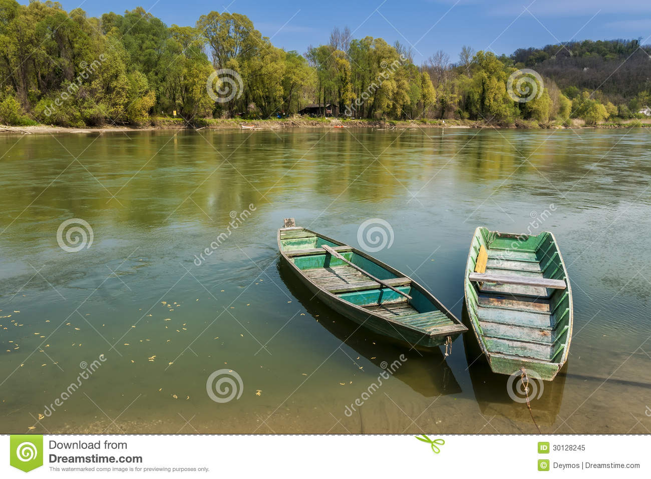 Two boats on the river bank