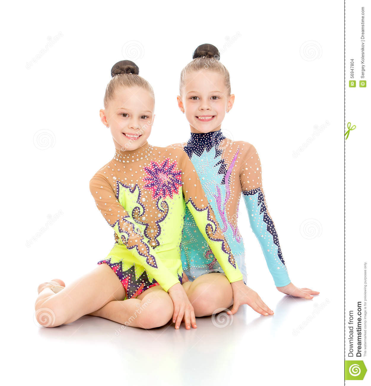 Two gymnasts sitting on the floor stock photo image for On the floor on the floor