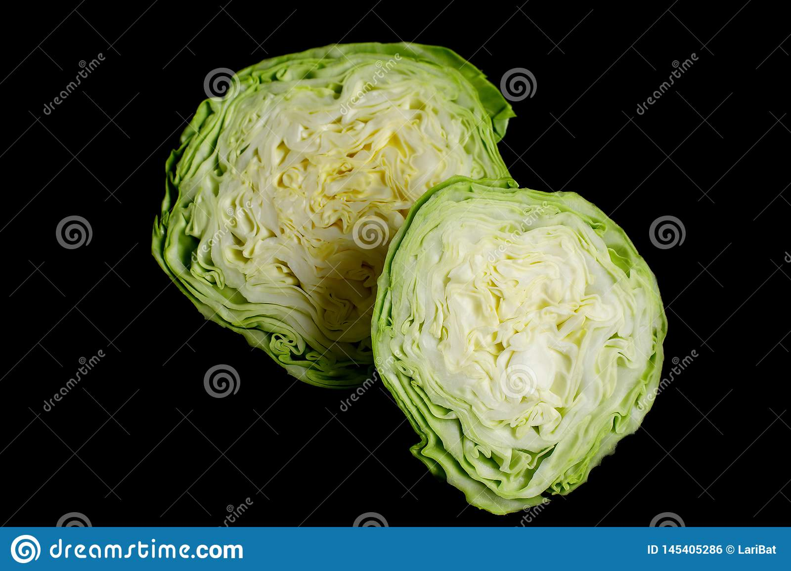 Two halves of white cabbage on a black background