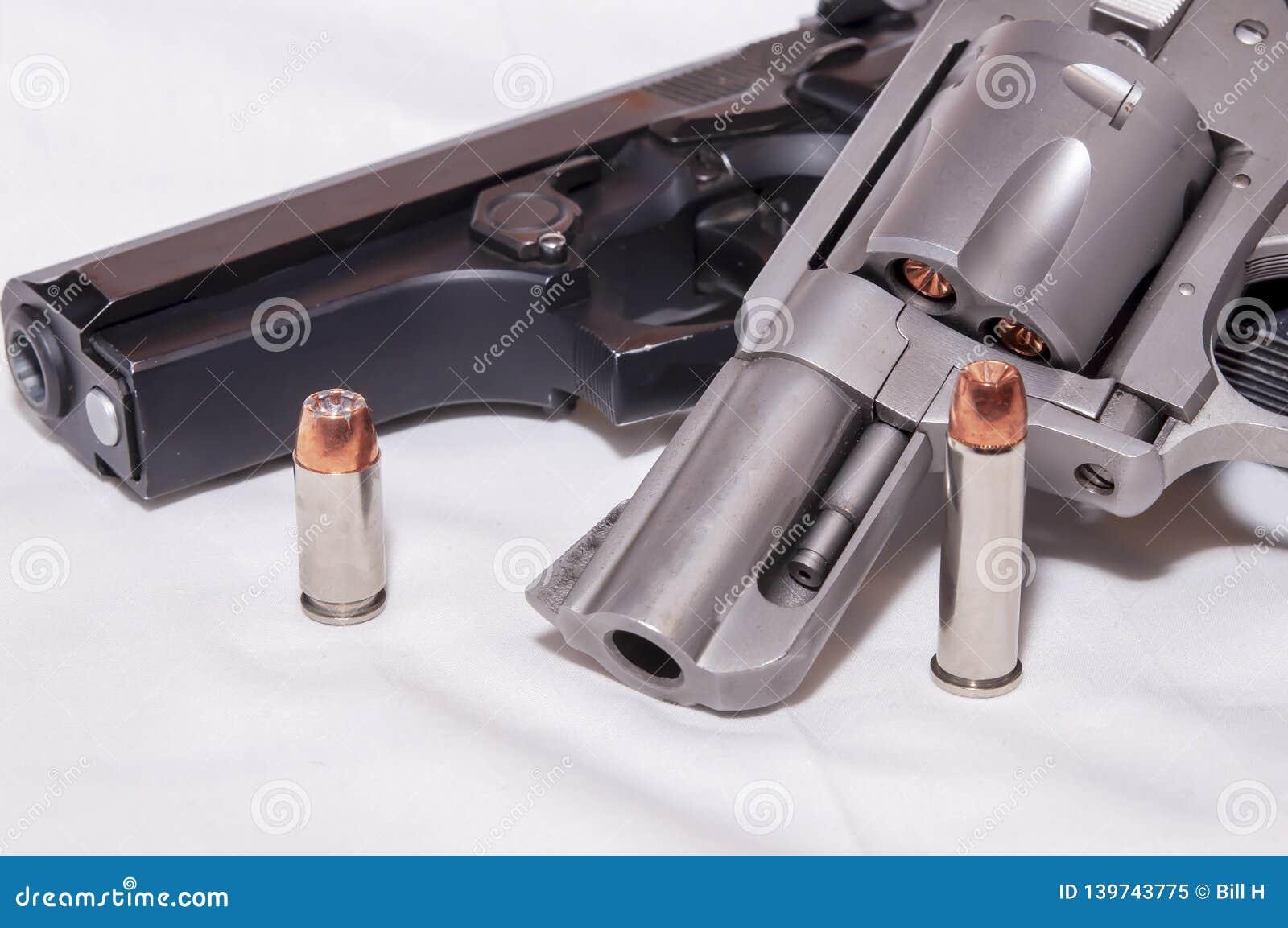 Two Handguns, A 357 Magnum Revolver And A Black 40 Caliber Pistol