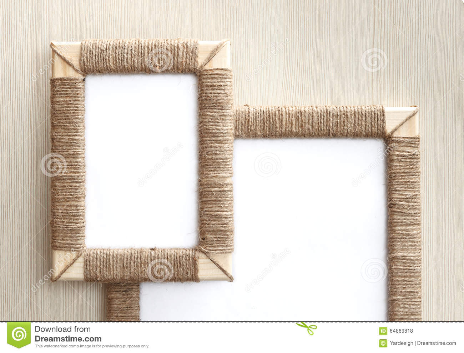 Two handmade photo frames braided jute against wooden background two handmade photo frames braided jute against wooden background jeuxipadfo Images