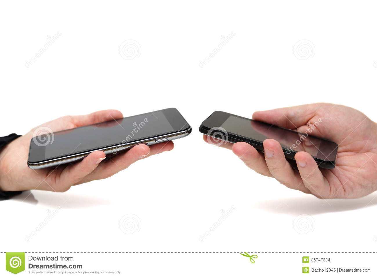 Two hands holding mobile smartphones while transferring data fro