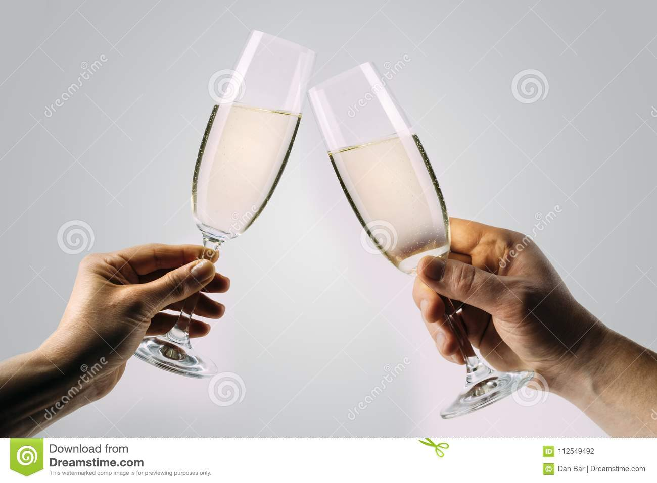 Two hands toasting champagne
