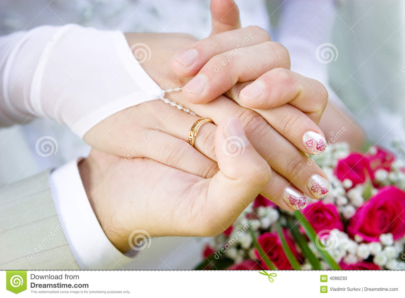 two hands with a wedding ring stock photo image 4088230