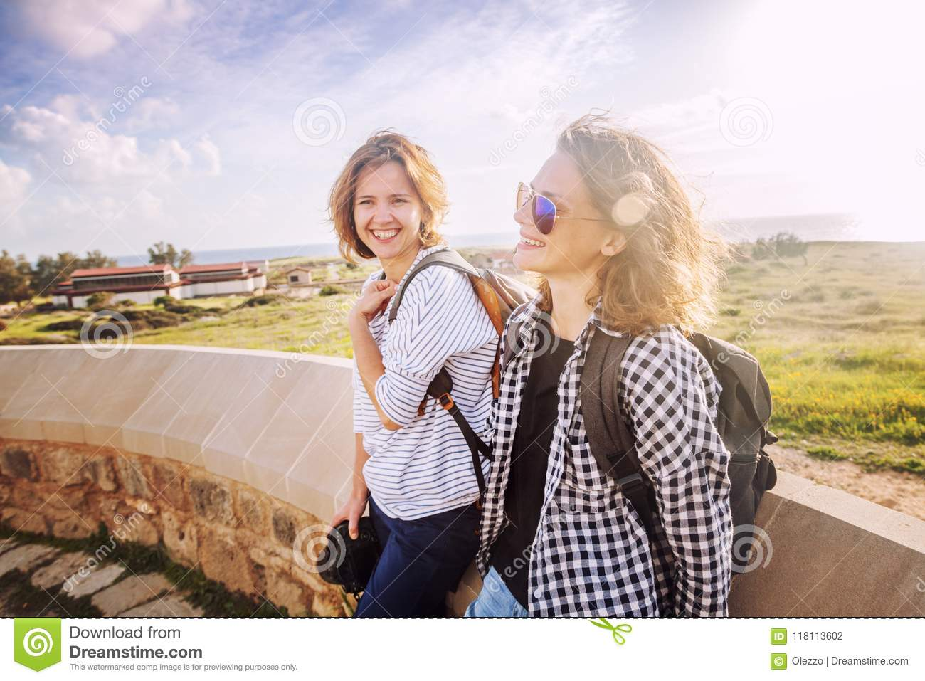 Two Happy Attractive Young Girls Traveling Together ffb80000e07a2