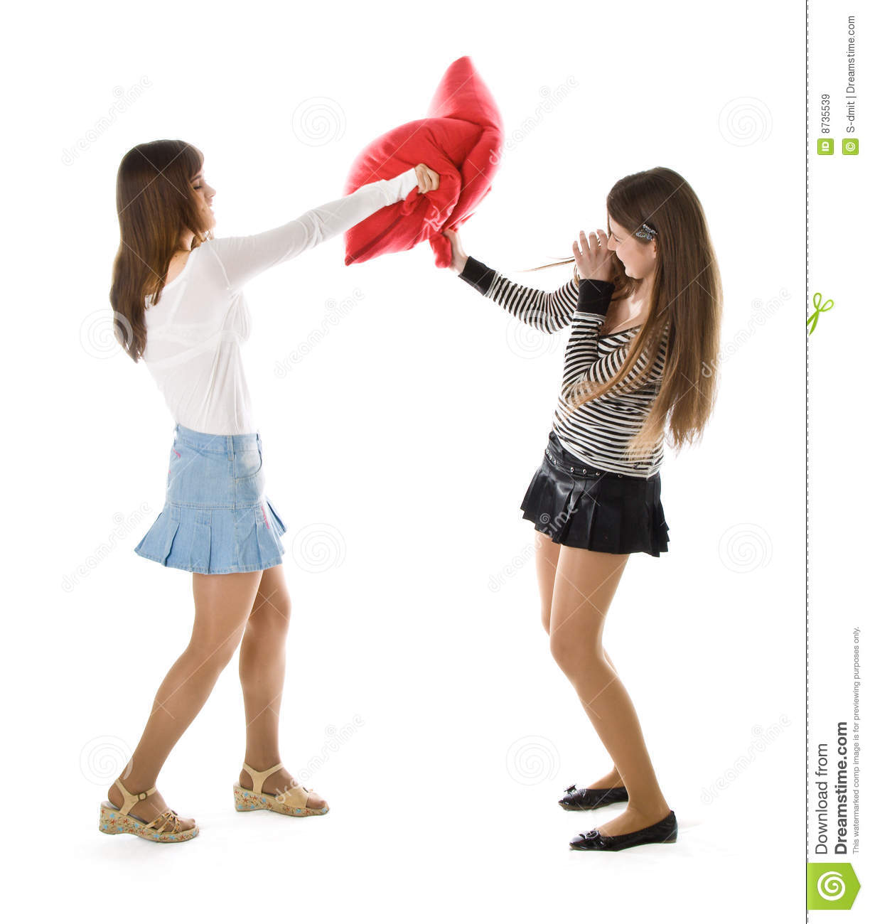 Two Beautiful Young Woman Fighting With Pillows Royalty