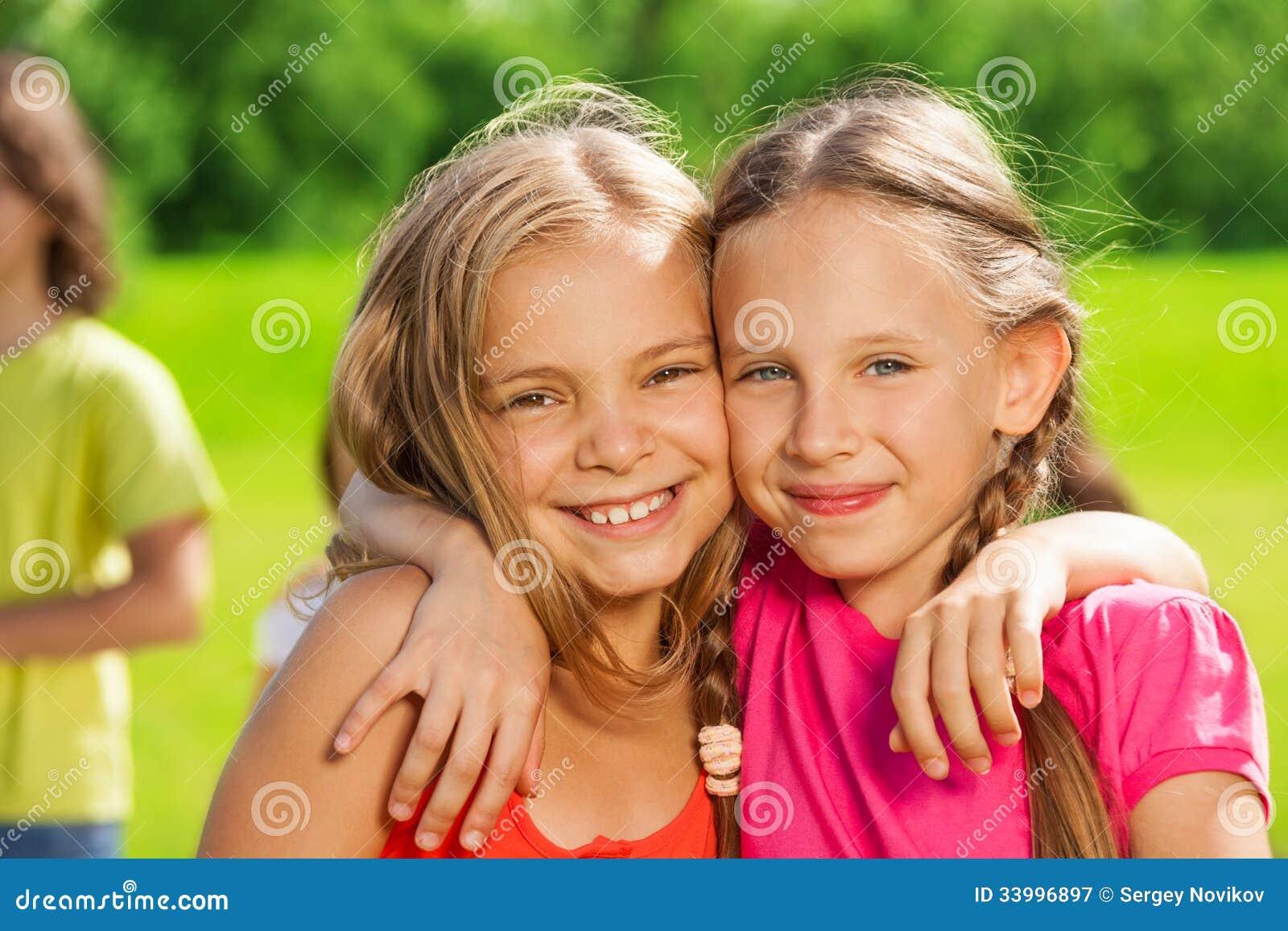 Two happy girls hugging